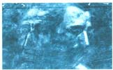 A radiography of the upper section of a painting shows another layer entirely hidden by the surface layer. This discovery will then be used by a historian to identify the characters.
